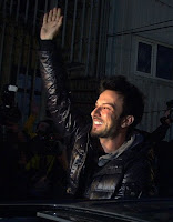Turkish pop singer Tarkan waves cheering supporters after his release outside a courthouse in Istanbul, Turkey, Monday, March 1, 2010. Turkish police detained Tarkan, the country's best-known pop star, in a narcotics raid Friday in Istanbul along with nine other people. Tarkan, who only uses one name, and others were detained for their alleged links with two drug dealers being monitored by narcotics agents, the state-run Anatolia news agency said. Police reportedly found and seized a small amount of hashish at the pop star's country home in the Omerli district near Istanbul, the agency said.(AP Photo )