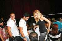 Turkish footballing hero Arda Turan and friend getting to his seat at Tarkan's 1 August show at the Harbiye in Istanbul
