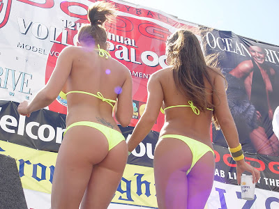 Two beach party girls in sexy bikinis showing their hot bodies.
