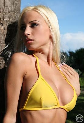 Sexy Blonde Posing in bikini bra to show her appetizing tits.