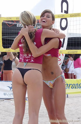 Two Sexy Beach Girls in hot bikinis are playing volleyball. What a nice asses in thong bikini panties.