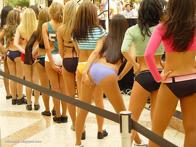 Bikini Contest Girls are waiting their turn. So many sexy girls asses in one place.