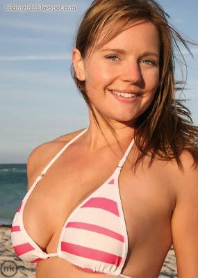 Pretty bikini girl in tight bikini top.