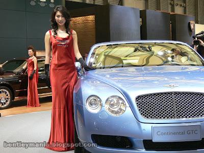 Sexy Asian Bentley Girl posing with Bentley Continental GTC