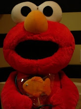 Elmo and his Goldfish Dorothy