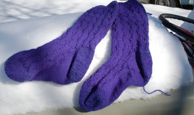 Completed socks in the snow