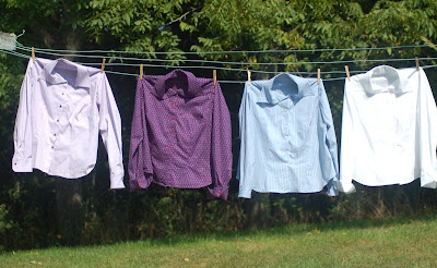 Four ladies' shirts on my clothesline