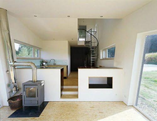 Fachada cubierta de cesped artificial amalia house for Ver fotos casas modernas por dentro