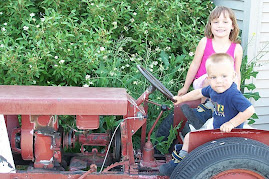 Lyndy and Sterling on tractor their great great uncle made from scratch