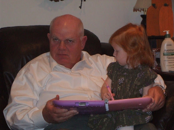 Abbie and Papa Reading a book