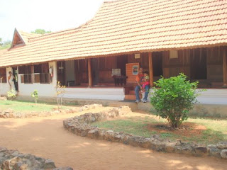 The kottayam achayan outside a typical syrian christian house from