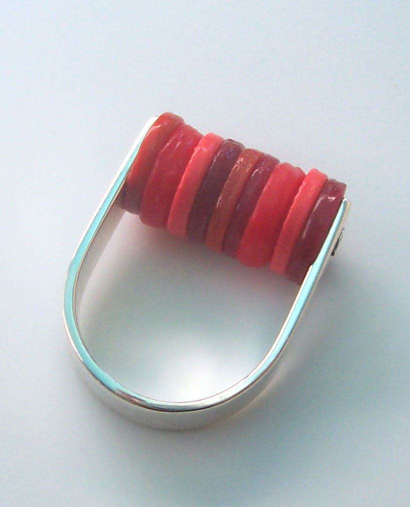 ring.jpg (image) :  plastic silver disk jewelry