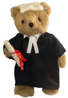 Teddy bear in wig and gown, from pupilblog