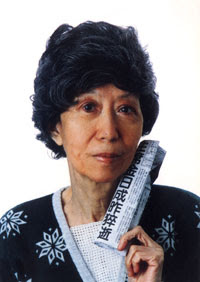 74 years old Eileen Chang was holding a newspaper which was reporting the death of Kim Il-sung