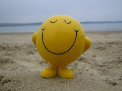 smiley face standing on beach