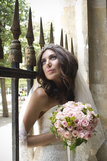 stylish wedding portrait of a bride in a Paris garden; Palais Royal