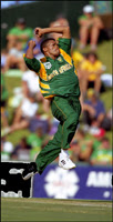 Makhaya Ntini bowling for South Africa