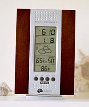 Wireless Forecast Station - wake up alarm, barometric pressure and its trend, temperature reading. Have a Mostly Sunny Day!