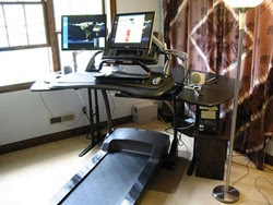 A walking vertical workstation - the treadmill desk.