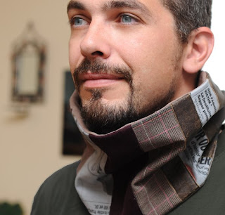 patched and striped masculine cowl or scarf, with pieces of newspaper print fabric