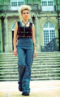 blue overalls and cropped sleeveless jacket French fashion designer