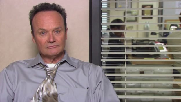 Creed from The Office with his black hair