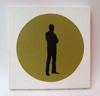 tableau vintage avec rond vert et silhouette d'homme années 70