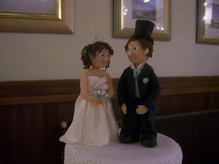Bride and Groom on top of Cornelli Wedding Cake