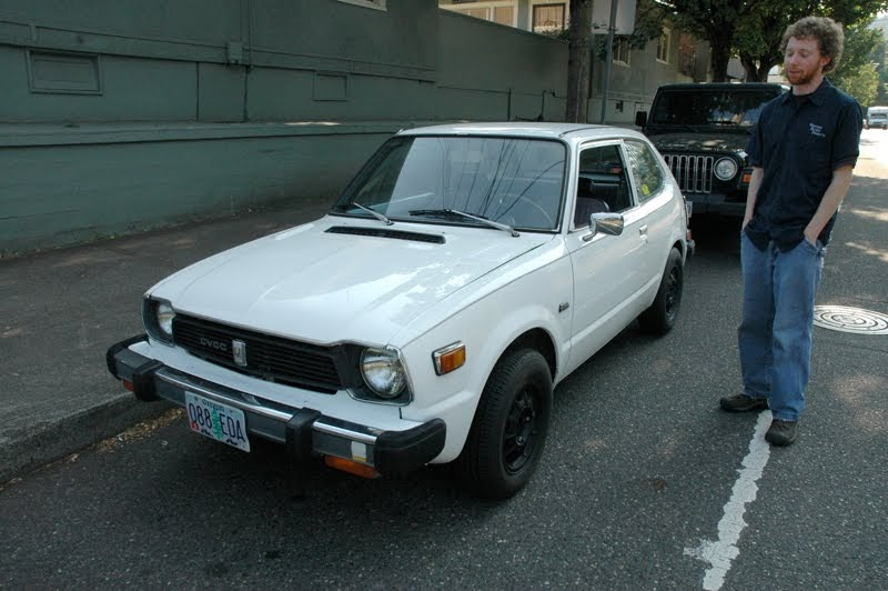 OLD PARKED CARS.: 1979 Honda Civic CVCC and Tristan.