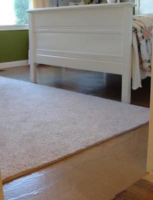 brown paper floor with rug