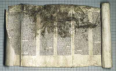 Desecrated Torah scroll fragment, recovered in 1945 from Pultusk, Poland, by Jerome Lipowicz, United States Holocaust Memorial Museum. Photograph by Arnold Kramer.