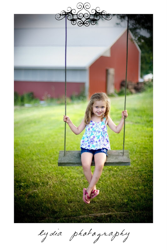 Little girl on the swign at lifestyle kids portraits on a farm in Indiana, Pennsylvania