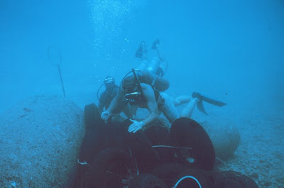 Tires being placed in an array to determine their effectiveness as habitat for fish  artificial reef