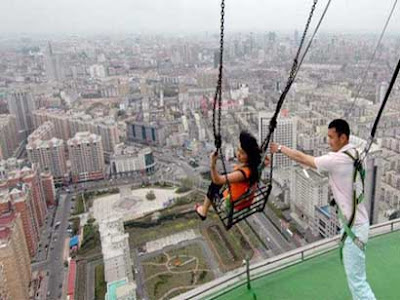 World's highest swing: set up on an 1,100 ft TV tower