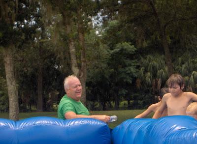 Pastor on fun water slide