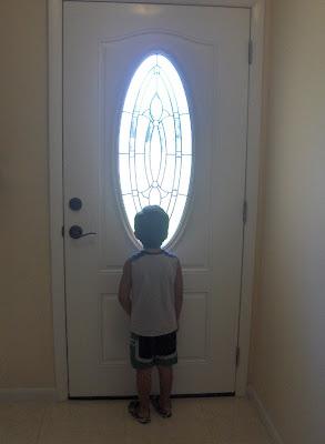 kid by door