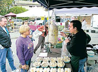 Nick Ochoa selling mushroom kits at Auburn Farmer's Market, December 2006.