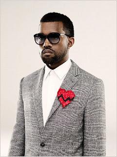 Kanye Charged Over Paparazzi Scuffle