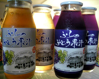 Close up of Hokkaido grape juice in glass bottles.