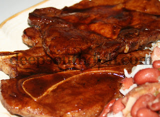 Bone-in pork chops, skillet seared and brushed with a spicy syrup and balsamic glaze.