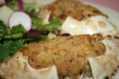 Stuffed crab, made with fresh lump crabmeat, onion, and bell pepper, seasoned with Old Bay and Cajun seasoning and bound with egg and toasted bread crumbs and baked.