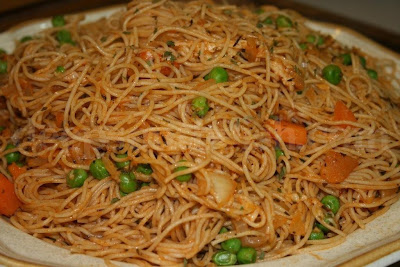 A simple pasta dish with carrots and peas and a light tomato sauce made with tomato paste.