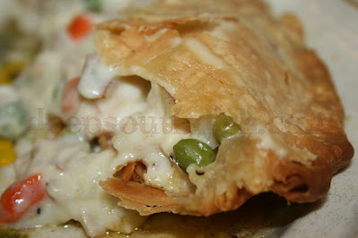An old fashioned chicken pot pie, made with a thick & creamy roux & veggies, encased in a flaky double crust.