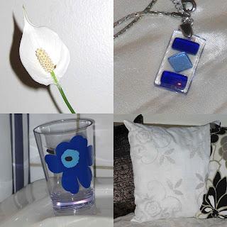 Vit fredslilja, blått halssmycke från Kreta, blå Marimekko-mugg, vit kudde
