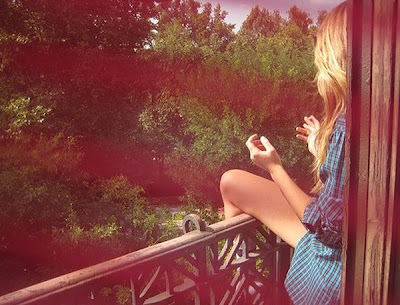 that i was on a balcony with my skinny legs hanging off, wearing my boyfriends shirt, looking at the forest.