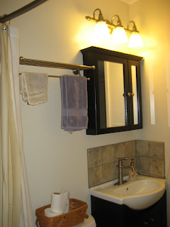 bathroom over cabinet light it s always an adventure with dave home remodeling 11623