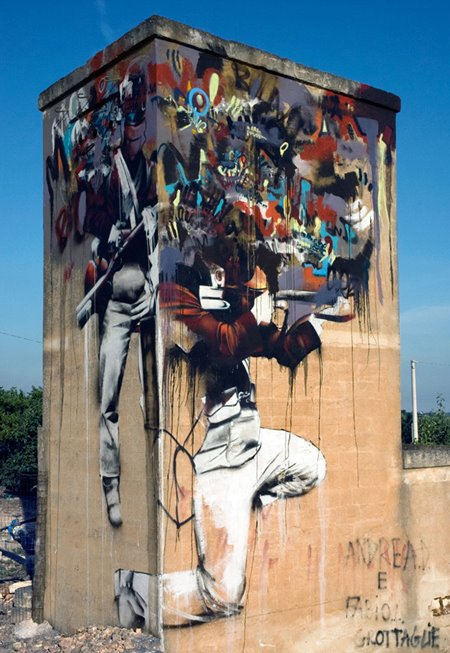 Irish artist Conor Harrington paints a mural in Southern Italy
