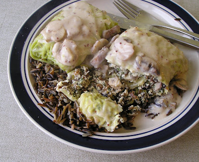 Vegetarian Cabbage Rolls with Cheese, Wild Rice and Mushroom Sauce