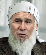 President George Bush dressing up as a muslim