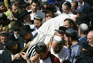 Israeli mourners carry the body of Segev Pniel Avihayil, 15,